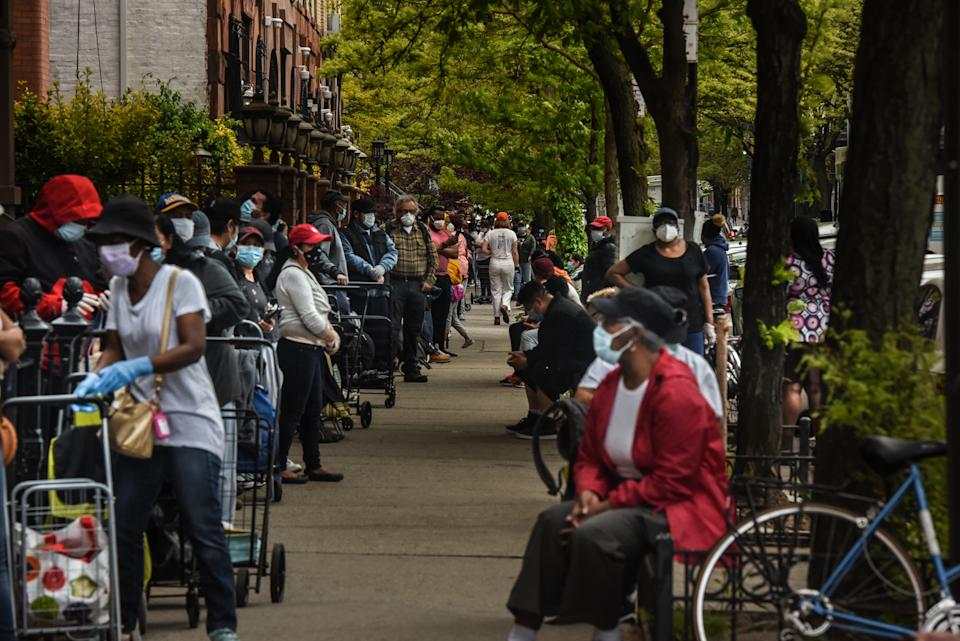 NEW YORK, NY - MAY 15: People wait on a long line to receive a food bank donation at the Barclays Center on May 15, 2020 in the Brooklyn boroughin New York City. The event was organized by Food Bank for New York City and included dairy and meat items. The sports arena in downtown Brooklyn, now closed, saw lines wrap around the block as New Yorkers struggle with unemployment and other financial stresses brought on by the COVID-19 outbreak. Across America, cities and towns are dealing with some of the highest unemployment rates since the Great Depression. (Photo by Stephanie Keith/Getty Images)