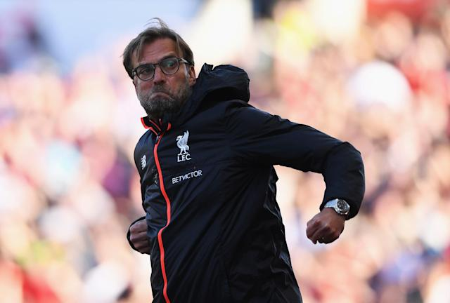 <p>Liverpool manager Jurgen Klopp celebrates by throwing some shapes</p>