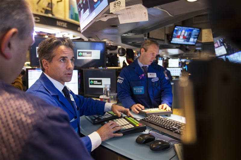 Traders work just before the end of trading for the day on the floor of the New York Stock Exchange