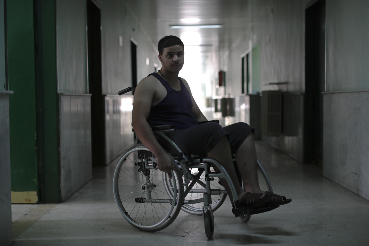 <p>A Syrian soldier who has paralysis is seen after a physical therapy session at the Ahmad Hamish Martyr hospital in Damascus, Syria. (Photo: Hassan Ammar/AP) </p>