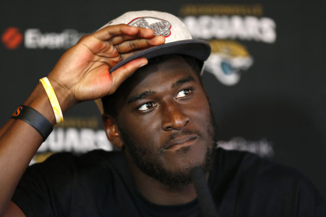 "FILE - In this Oct. 23, 2013, file photo, Jacksonville Jaguars' wide receiver Justin Blackmon speaks to the media during a press conference at the Pennyhill Park Hotel and Spa in Bagshot, England. The Jaguars expect to be without their suspended receiver all season, maybe even longer. General manager Dave Caldwell said Friday, May 2, 2014, it would be ""relatively surprising"" to have Blackmon back on the field this fall. Blackmon is suspended indefinitely without pay for repeated violations of the league's substance-abuse policy. (AP Photo/Sang Tan, File)"