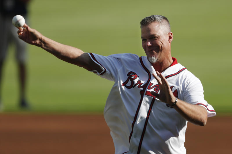 Former Atlanta Braves player and MLB Hall of Fame baseball player Chipper Jones throws the a ceremonial pitch ahead of Game 1 of a best-of-five National League Division Series between the Atlanta Braves and the St. Louis Cardinals, Thursday, Oct. 3, 2019, in Atlanta. (AP Photo/John Bazemore)