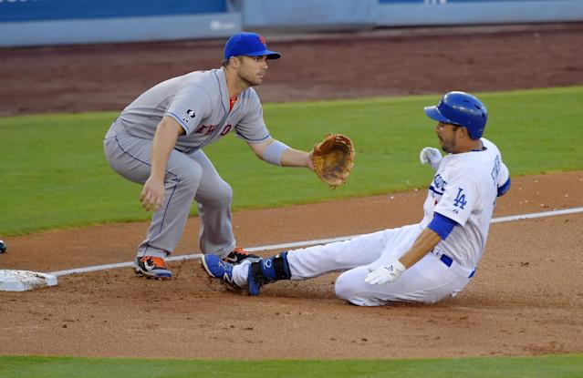 Los Angeles Dodgers' Andre Ethier, right, slides into third for a triple as New York Mets third baseman David Wright takes a late throw during the second inning of a baseball game, Saturday, Aug. 23, 2014, in Los Angeles. (AP Photo/Mark J. Terrill)