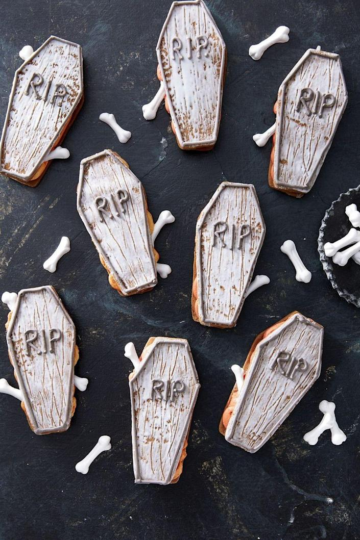 """<p>These coffin cookies have a buttercream filling that's to <em>die</em> for.  </p><p><strong><em>Get the recipe at <a href=""""https://www.countryliving.com/food-drinks/a28943552/coffin-sandwich-cookies/"""" rel=""""nofollow noopener"""" target=""""_blank"""" data-ylk=""""slk:Country Living."""" class=""""link rapid-noclick-resp"""">Country Living. </a></em></strong></p>"""