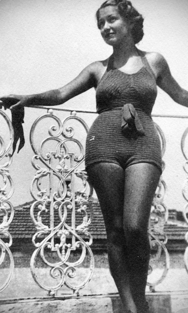 Young woman with swimwear on a balcony. (Photo: Getty Images)