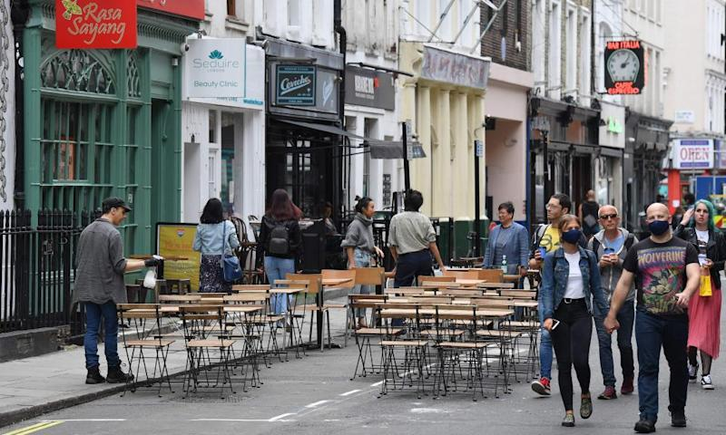 Tables have been put out for customers outside a restaurant in Soho.