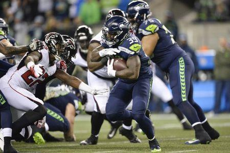 Nov 20, 2017; Seattle, WA, USA; Seattle Seahawks running back Mike Davis (39) carries the ball against the Atlanta Falcons during the first half at CenturyLink Field. Atlanta defeated Seattle 34-31. Steven Bisig-USA TODAY Sports