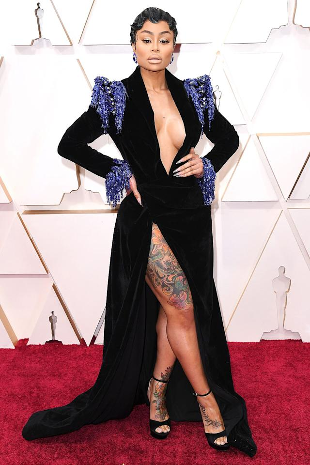 "Have you been keeping up with Chyna? The reality star made her <a href=""https://people.com/style/2020-oscars-blac-chyna-red-carpet-skin-baring-high-slit-gown/"">very first Academy Awards appearance</a> on Sunday night, and she chose to stun in a floor-length, long-sleeved black velvet dress with a plunging neckline and high slit.  Although she is not presenting during the show or nominated for any of the films, we can't wait to see where she's seated inside."