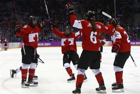 Canada's Jenner celebrates her goal against Team USA with teammates Ward, Johnston and Irwin during the third period during the third period of their women's ice hockey gold medal game at the Sochi 2014 Winter Olympic Games