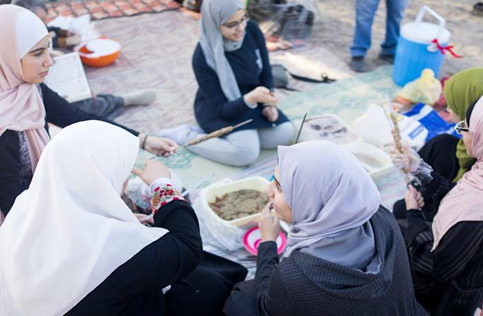 """<span class=""""caption"""">Weekend in the Islamic world usually means Friday and Saturday.</span> <span class=""""attribution""""><a class=""""link rapid-noclick-resp"""" href=""""https://www.gettyimages.com/detail/photo/arab-family-gathering-around-food-outdoors-royalty-free-image/1141444355?adppopup=true"""" rel=""""nofollow noopener"""" target=""""_blank"""" data-ylk=""""slk:Jasmin Merdan/Moment Archive via Getty Images"""">Jasmin Merdan/Moment Archive via Getty Images</a></span>"""