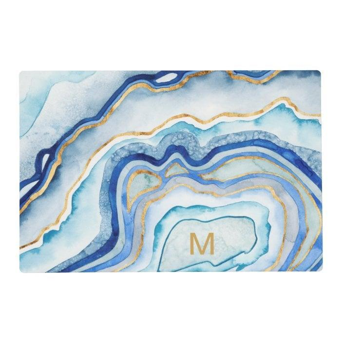 <p>This <span>Monogram Cobalt Agate II Placemat</span> ($15, plus 15% off with code MIDMARCHSALE) will embellish your dinner table.</p>