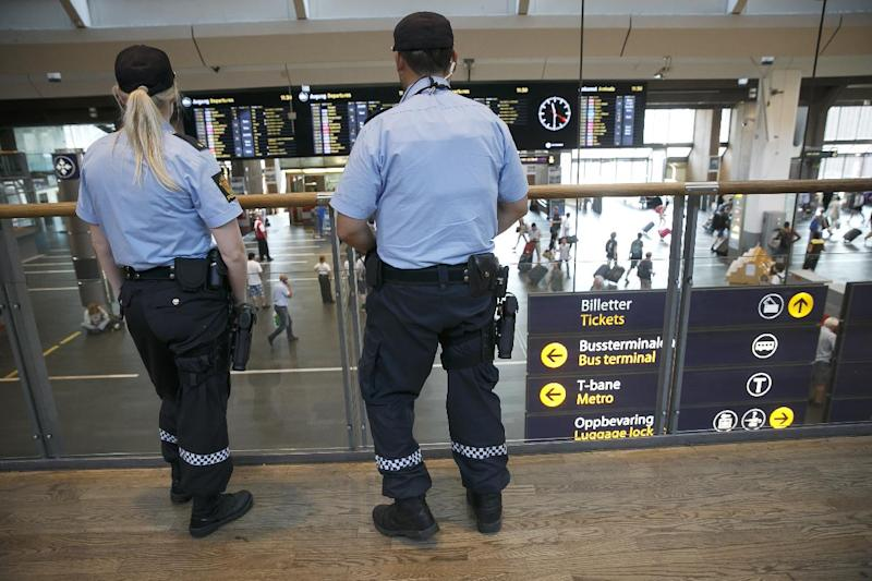 Armed police patrol at the central railway station in Oslo on July 25, 2014 as after Norway steps up security following a terror alert