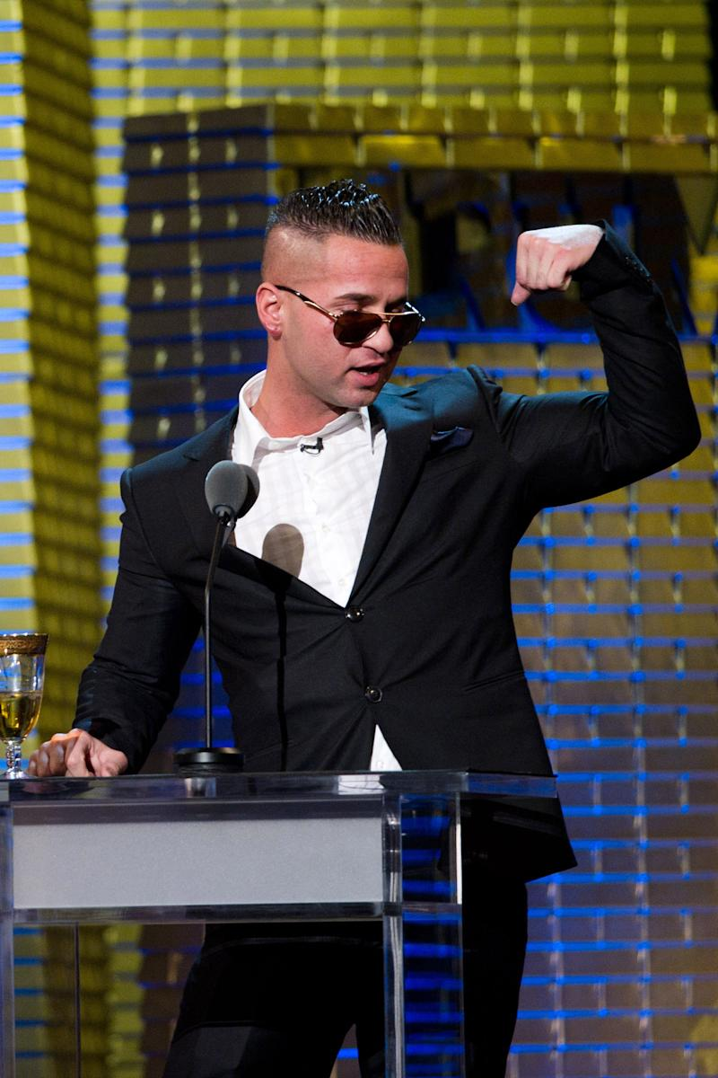"""In a March 9, 2011 photo Mike """"The Situation"""" Sorrentino appears onstage at the Comedy Central Roast of Donald Trump in New York.   Abercrombie & Fitch Co. says in a news release Tuesday Aug. 16, 2011 that they are concerned that having Sorrentino  seen in its clothing could cause """"significant damage"""" to the company's image, and has offered a payment for him and other cast members of """"Jersey Shore"""" to not wear the company's clothes on the show. (AP Photo/Charles Sykes)"""