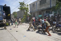 Police confront residents who temporarily overtook a truck loaded with relief supplies, in Les Cayes, Haiti, Friday, Aug. 20, 2021. Private aid and shipments from the U.S. government and others were arriving in the country's southwestern peninsula that was struck by a 7.2 magnitude quake on Aug. 14. (AP Photo/Fernando Llano)