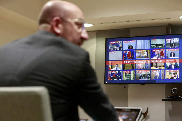 FILE - In this Tuesday, March 10, 2020 file photo, European Council President Charles Michel participates in a video conference call with EU leaders at the European Council building in Brussels. European Union leaders are preparing for a new virtual summit, which will take place Thursday, April 23, 2020, to take stock of the damage the coronavirus has inflicted on the lives and livelihoods of the bloc's citizens and to thrash out a more robust plan to revive their ravaged economies. (Stephanie Lecocq, Pool Photo via AP, File)