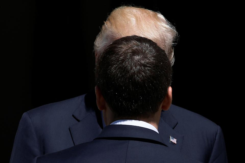 U.S. President Donald Trump greets French President Emmanuel Macron before a lunch ahead of a NATO summit in Brussels, Belgium, on May 25, 2017.