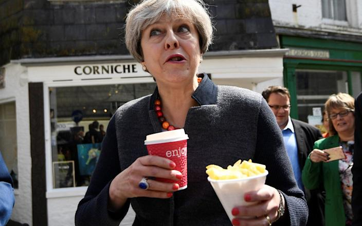 Theresa May was never the most natural in front of the camera - PA