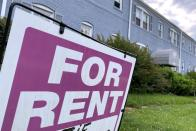 """FILE PHOTO: A """"For Rent"""" sign is displayed in front of an apartment building in Arlington, Virginia, U.S."""