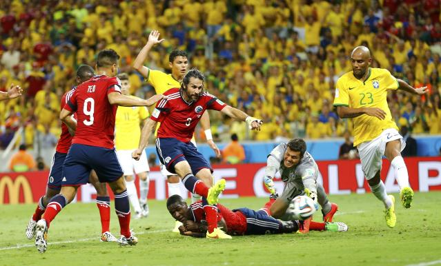 Colombia's Mario Yepes (3) scores a goal, which was later declared offside, during the 2014 World Cup quarter-finals between Brazil and Colombia at the Castelao arena in Fortaleza July 4, 2014. REUTERS/Marcelo Del Pozo (BRAZIL - Tags: TPX IMAGES OF THE DAY SOCCER SPORT WORLD CUP)