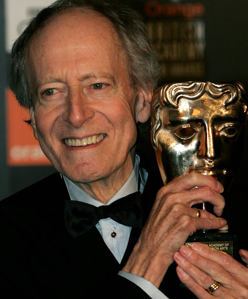 FILE - This is a Saturday, Feb. 12, 2005 file photo composer John Barry as he holds his Academy Fellowship award at the British Academy Film Awards in London's Leicester Square. British film composer John Barry, who won five Oscars and is best known for creating music for the James Bond movies, has died at age 77. Barry's family said Monday Jan. 31. 2011 that he had died in New York on Sunday.
