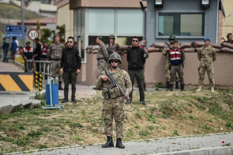 Turkish soldiers guarded the Aliaga court and prison complex as Brunson's trial got under way (AFP Photo/OZAN KOSE)