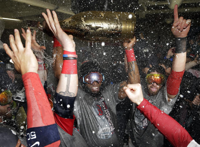 The Red Sox's David Ortiz celebrates with teammates after Game 6 of the 2013 World Series against the St. Louis Cardinals. It was the first of two World Series titles for the Red Sox in the 2010s. (AP)
