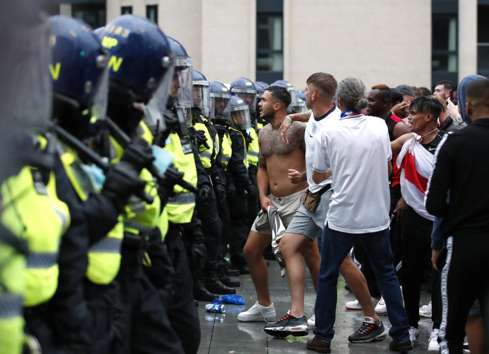 England football fans clash with police outside Wembley stadium during England v Italy Euro 2020 finals on 11 July. Photo: Peter Cziborra/Reuters