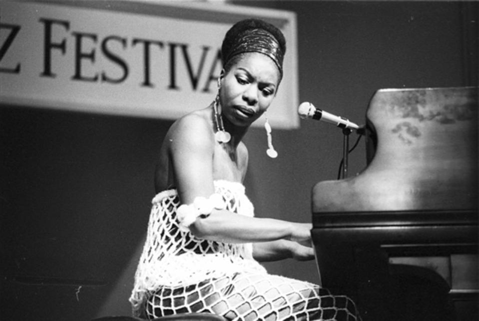 <p>Beginning her career as a classically trained pianist who had studied at The Juilliard School, Nina Simone fell into singing jazz while working at a nightclub in Atlantic City. Despite her talent, Simone suffered through many hardships throughout her life, having been in a reportedly abusive relationship and struggling with bipolar disorder. She became an outspoken political activist during the Civil Rights Movement, and often wore bright, colorful dresses and head wraps, looking undeniably chic at all times.<i> (Photo: Getty Images)</i></p>