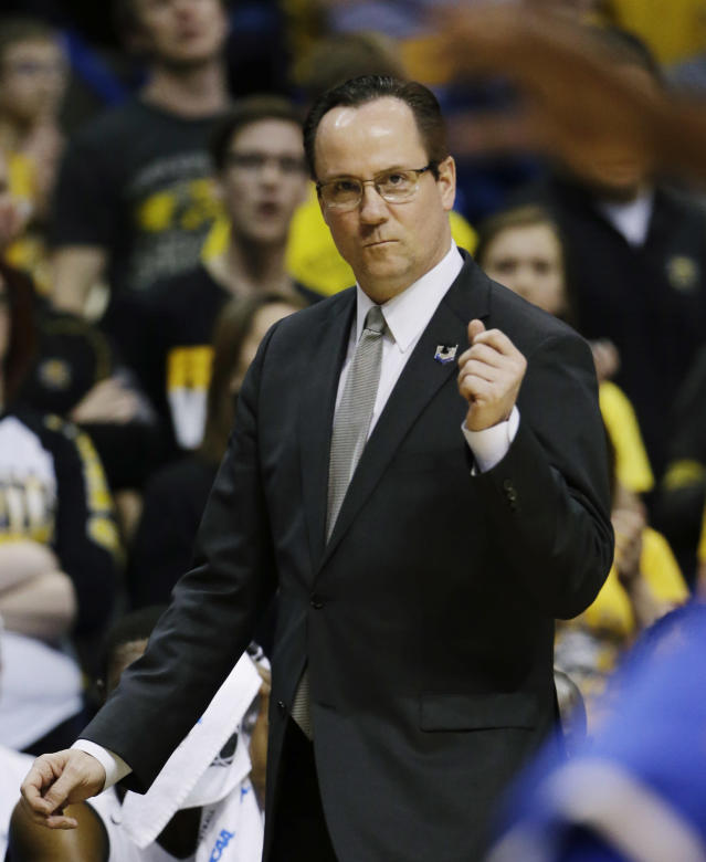 Wichita State head coach Gregg Marshall walks the sideline against Kentucky during the first half of a third-round game of the NCAA college basketball tournament Sunday, March 23, 2014, in St. Louis. (AP Photo/Jeff Roberson)