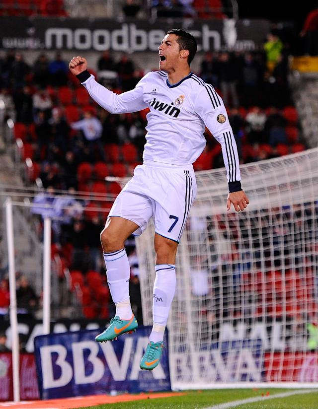 MALLORCA, SPAIN - OCTOBER 28: Cristiano Ronaldo of Real Madrid CF celebrates after scoring his team's fourth goal during the La Liga match between RCD Mallorca and Real Madrid CF at Iberostar Stadium on October 28, 2012 in Mallorca, Spain. (Photo by David Ramos/Getty Images)