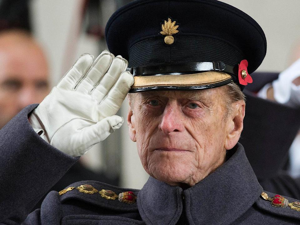 Prince Philip salutes during a special Armistice Day ceremony under the Menin Gate in Ypres, Belgium, on 11 November 2013 (AP)