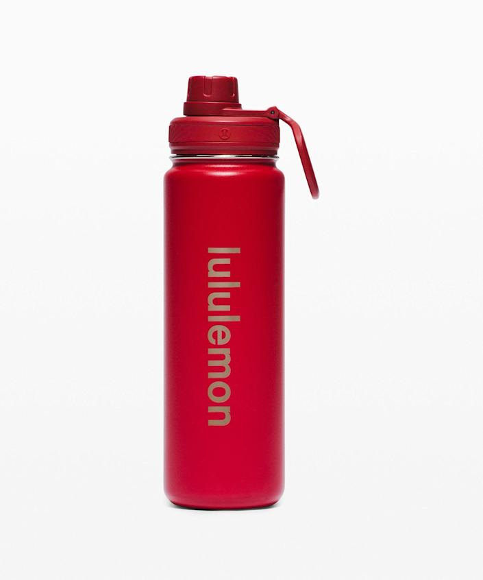 """<p><strong>Lululemon</strong></p><p>lululemon.com</p><p><strong>$44.00</strong></p><p><a href=""""https://go.redirectingat.com?id=74968X1596630&url=https%3A%2F%2Fshop.lululemon.com%2Fp%2Fwater-bottles%2FBack-To-Life-Sport-Bottle-LNY%2F_%2Fprod10420053&sref=https%3A%2F%2Fwww.cosmopolitan.com%2Fstyle-beauty%2Ffashion%2Fg35293423%2Flululemon-dropped-a-whole-new-collection-for-lunar-new-year-2020%2F"""" rel=""""nofollow noopener"""" target=""""_blank"""" data-ylk=""""slk:Shop Now"""" class=""""link rapid-noclick-resp"""">Shop Now</a></p><p>Keep your hydration on lock with a leak-proof lid and double-lined inner to prevent sweat. Plus, a loop for on-the-go. </p>"""