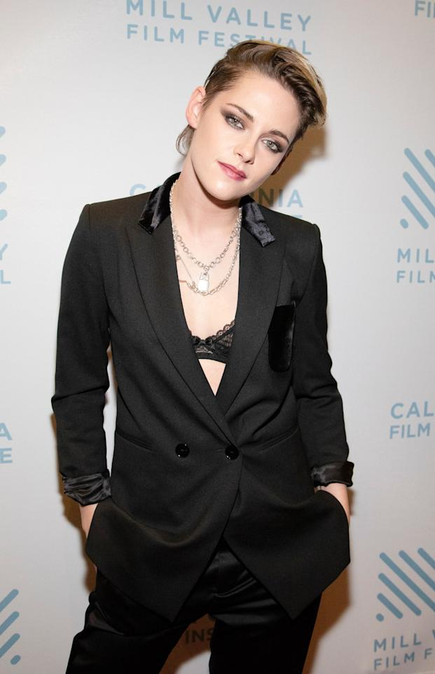 Kristen rocked a peekaboo lace bra and a few silver chains under her fitted black suit for a <em>Seberg</em> premiere in California.