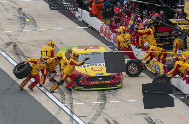 Joey Logano (22) pits during the Drydene 400 NASCAR Cup Series playoff auto race, Sunday, Oct. 6, 2019, at Dover International Speedway in Dover, Del. (AP Photo/Jason Minto)