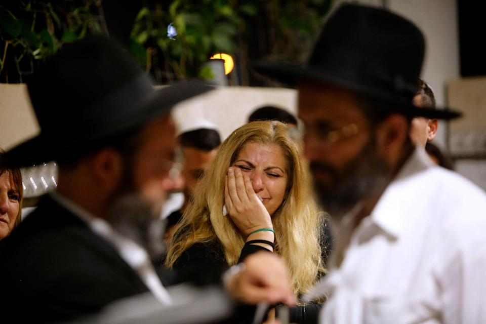 <p>Mourners react during the funeral of Lea Yom Tov, an Israeli woman killed by a rocket attack from the Gaza Stip, in the central city of Rishon LeZion</p> (AFP via Getty Images)