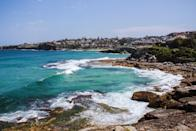 """<p><strong>Give us the wide-angle view: what kind of beach are we talking about?</strong><br> The iconic six-kilometer Bondi to Coogee Coastal Walk takes in five beaches and two bays, and is one of Sydney's most scenic seaside walks. Winding south from <a href=""""https://www.cntraveler.com/activities/sydney/bondi-beach?mbid=synd_yahoo_rss"""" rel=""""nofollow noopener"""" target=""""_blank"""" data-ylk=""""slk:Bondi Beach"""" class=""""link rapid-noclick-resp"""">Bondi Beach</a>, the path climbs over steep headland lookout Marks Park before dropping down past dog-friendly, rock pool-dotted Mackenzies Bay to small, surf-lashed Tamarama Beach, skipping on to family-friendly Bronte Beach, cutting through historic Waverley Cemetery to skinny snorkeling spot Clovelly Beach, passing pretty, boat-fringed Gordon's Bay, and finally heading up and over to Coogee Beach's sweeping sands. You can tackle it in either direction, but most folks kick off from Bondi. Plan around two hours for the walk, plus extra time for swimming and snacking.</p> <p><strong>Lovely. How accessible is it?</strong><br> Bondi Beach is just seven kilometers from Sydney's city center: take a train to Bondi Junction and then the bus (333 or 380), or bus all the way. Hop off at the first stop on beachfront Campbell Parade, opposite Notts Avenue, where the walk starts beyond Icebergs Pool. From Coogee, buses run back to Bondi Junction and the city.</p> <p><strong>Decent services and facilities, would you say?</strong><br> Sneakers are best for this paved trail, which features some steep steps. Bring your swimwear, towel, and snorkeling gear, plus a hat, sunscreen, and water bottle. Bondi's Campbell Parade has beach stores. You'll find water fountains, changing rooms, toilets, and cafés along the way, including The Crabbe Hole beside Bondi's Icebergs Pool, Tama Café's shady terrace at Tamarama Beach, and lunch spots at Bronte Road's café strip and Clovelly's Seasalt Café. Coogee Pavilion features a ground-floor restaurant and rooftop ba"""