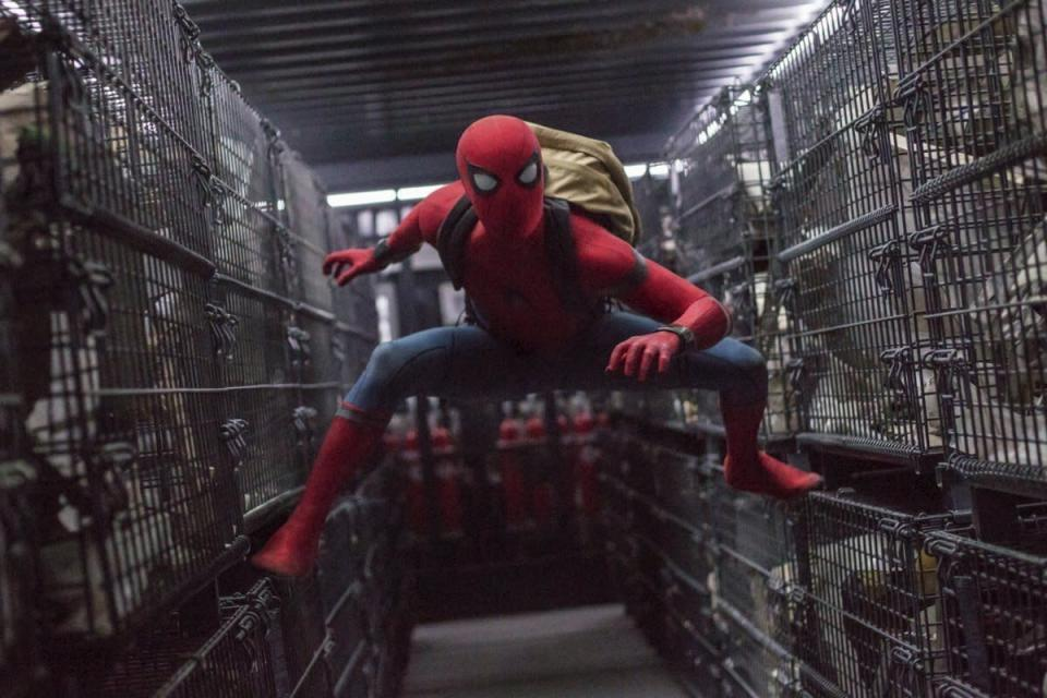 "This image released by Columbia Pictures shows Tom Holland in a scene from ""Spider-Man: Homecoming."" Netflix scored a multi-year deal that will make it the new streaming home to Sony Pictures' top releases in the U.S. Beginning next year, Sony's new films will stream domestically on Netflix after their theatrical runs. That includes movies in popular franchises like ""Spider-Man,"" ""Venom"" and ""Jumanji."" (Chuck Zlotnick/Columbia Pictures-Sony via AP)"