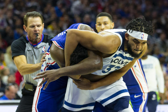 Joel Embiid #21 of the Philadelphia 76ers gets in a fight with Karl-Anthony Towns #32 of the Minnesota Timberwolves. (Credit: Getty Images)