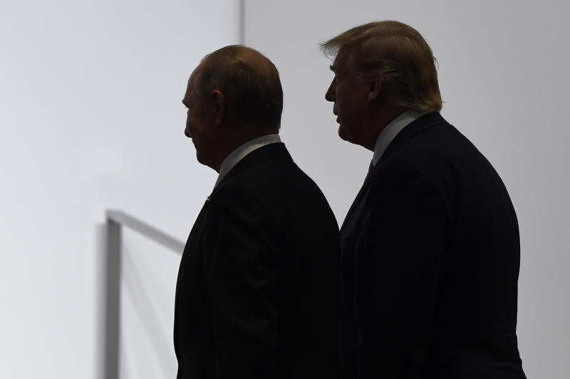 FILE - In this June 28, 2019, file photo, President Donald Trump and Russian President Vladimir Putin walk to participate in a group photo at the G20 summit in Osaka, Japan. The Trump administration is notifying international partners that it is pulling out of a treaty that permits 30-plus nations to conduct unarmed, observation flights over each other's territory — overflights set up decades ago to promote trust and avert conflict. The administration says it wants out of the Open Skies Treaty because Russia is violating the pact and imagery collected during the flights can be obtained quickly at less cost from U.S. or commercial satellites. (AP Photo/Susan Walsh, File)