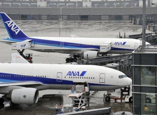 All Nippon Airways (ANA) planes are parked at Tokyo airport