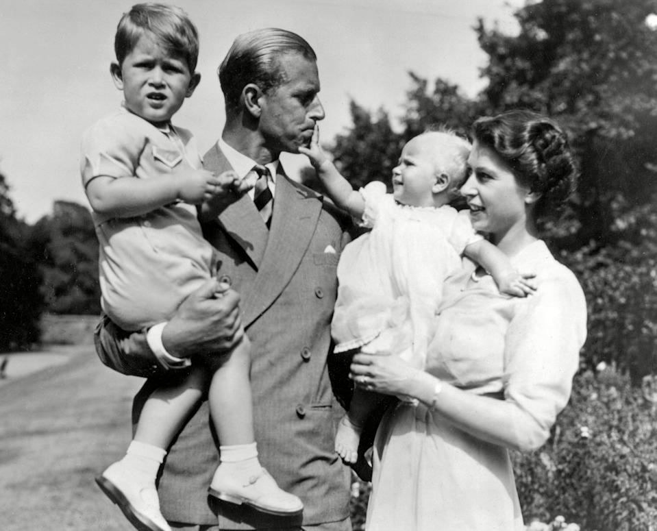 <p>Queen Elizabeth II and the Duke of Edinburgh holding Prince Charles and Princess Anne, 1952</p> (Universal History Archive/Shutterstock)