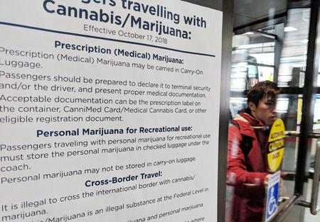 A travel advisory about marijuana possession while traveling is posted at Toronto Coach Terminal in Toronto, Ontario, Canada, October 18, 2018.  REUTERS/Hyungwon Kang