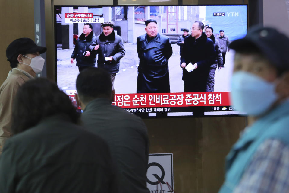 "People watch a TV showing a file image of North Korean leader Kim Jong Un during a news program at the Seoul Railway Station in Seoul, South Korea, Saturday, May 2, 2020. Kim made his first public appearance in several weeks as he celebrated the completion of a fertilizer factory near Pyongyang, state media said Saturday, ending an absence that had triggered global rumors that he was seriously ill. The sign reads: ""Kim Jong Un attended a ceremony marking the completion of a fertilizer factory."" (AP Photo/Ahn Young-joon)"