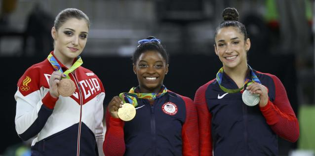2016 Rio Olympics - Artistic Gymnastics - Final - Women's Individual All-Around Victory Ceremony - Rio Olympic Arena - Rio de Janeiro, Brazil - 11/08/2016. Simone Biles (USA) of the U.S., Alexandra Raisman (USA) of the U.S. and Aliya Mustafina (RUS) of Russia pose with their medals. REUTERS/Mike Blake FOR EDITORIAL USE ONLY. NOT FOR SALE FOR MARKETING OR ADVERTISING CAMPAIGNS.