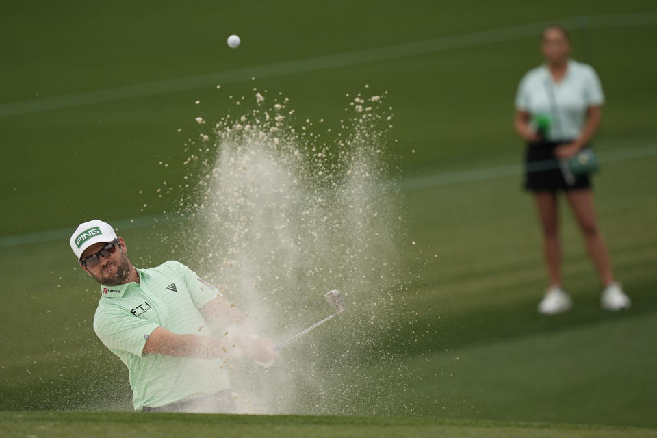 Corey Conners, of Canada, blasts out of a bunker on the second hole during the third round of the Masters golf tournament on Saturday, April 10, 2021, in Augusta, Ga. (AP Photo/David J. Phillip)