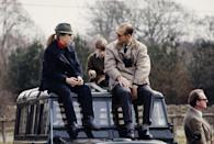 <p>Prince Philip and his daughter, Princess Anne, sit on the hood of a Land Rover on a day out together in 1980. </p>