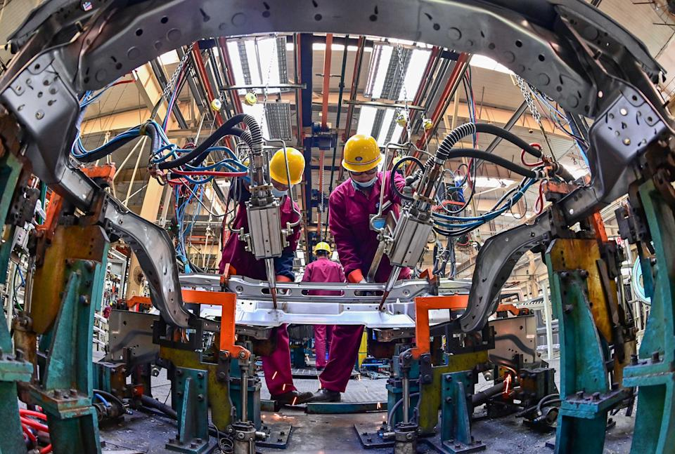 QINGZHOU, CHINA - APRIL 30, 2021 - Workers work at a welding workshop of an automobile manufacturer in Qingzhou, east China's Shandong Province, April 30, 2021. China's manufacturing purchasing managers' index was 51.1 per cent in April. (Photo credit should read Costfoto/Barcroft Media via Getty Images)