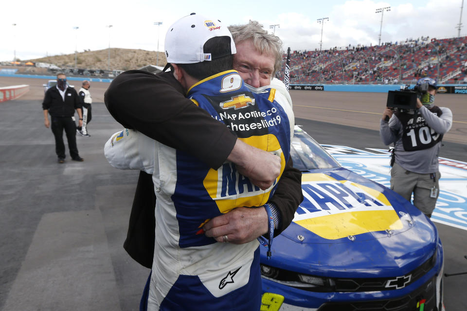 Chase Elliott hugs his father Bill Elliott after winning the season championship during a NASCAR Cup Series auto race at Phoenix Raceway, Sunday, Nov. 8, 2020, in Avondale, Ariz. Bill is also a former series champion. (AP Photo/Ralph Freso)