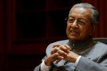 FILE PHOTO: Malaysia's Prime Minister Mahathir Mohamad speaks during an interview with Reuters in Putrajaya, Malaysia June 19, 2018. REUTERS/Lai Seng Sin/File Photo