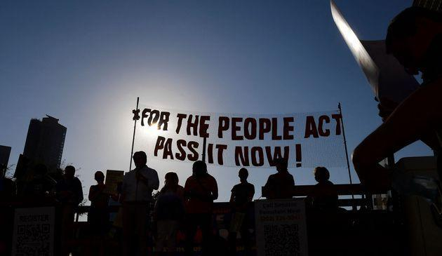 Activists from various grassroots organizations rally outside City Hall in Los Angeles on July 7 to call on Congress and Sen. Dianne Feinstein (D-Calif.) to remove the filibuster and pass the For the People Act to expand voting rights. (Photo: FREDERIC J. BROWN via Getty Images)